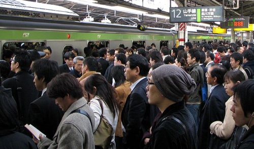 Morning commuters hoping to board a train that's already full