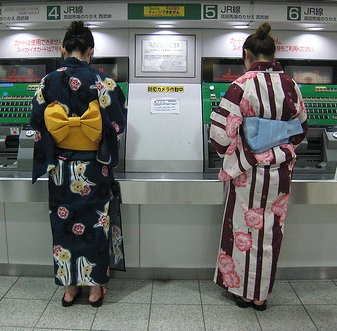 In the summer, young Tokyoites can often be seen wearing Yukata (informal Kimono), like these women buying tickets in Shinjuku Station